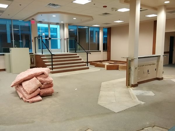 The old reception desk has mostly come down, and what remains will be a counter for residents to use before stepping up to the window.