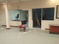 Holes have been cut in the wall for the Police Records and Front Desk windows.