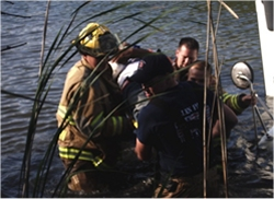 Firefighters helping during water rescue